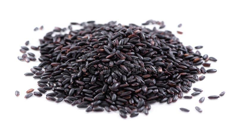 Schwarzer Reis (lokalisiert auf Weiß) stockbilder