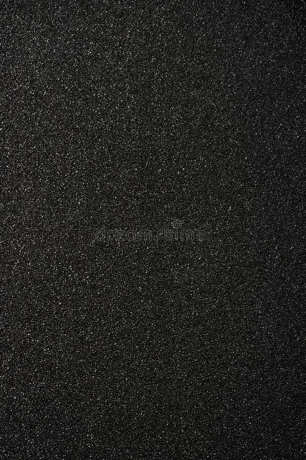 Schwarzer Sandhintergrund stockbild