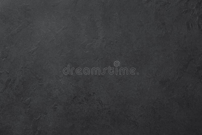 Schwarzer Schiefer- oder Steinbeschaffenheitshintergrund lizenzfreies stockfoto