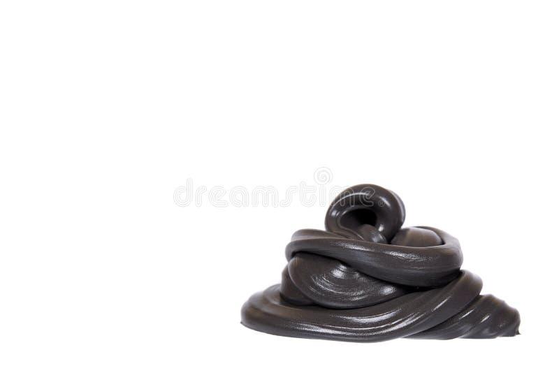 Schwarzer Schlamm f?r Kinder, transparentes lustiges Spielzeug stockfotos