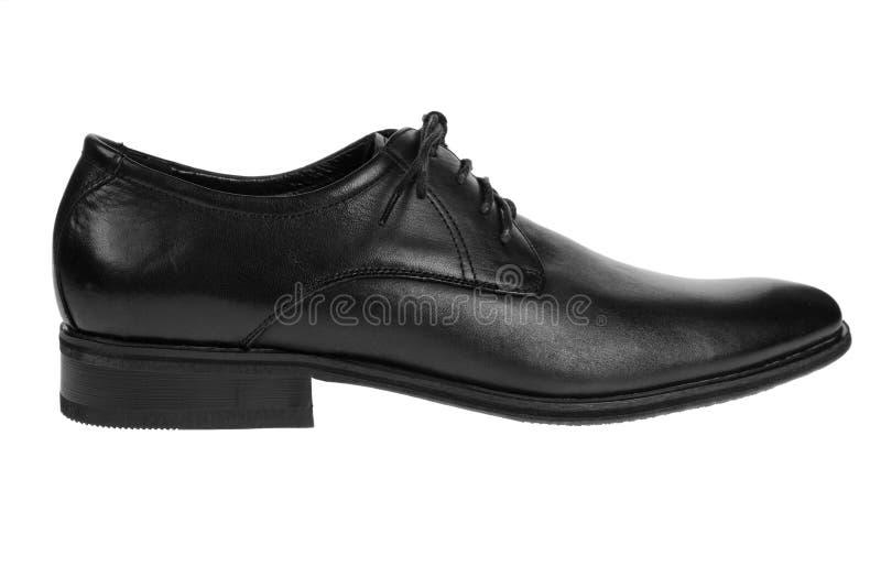 Schwarzer Schuh auf Weiß stockfotos