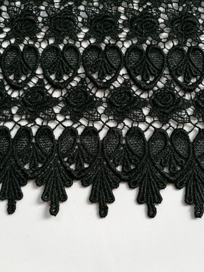 Schwarzer Spitzebeschaffenheitsmit blumenhintergrund lizenzfreies stockbild