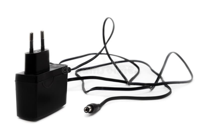 Schwarzer Stromadapter stockbild