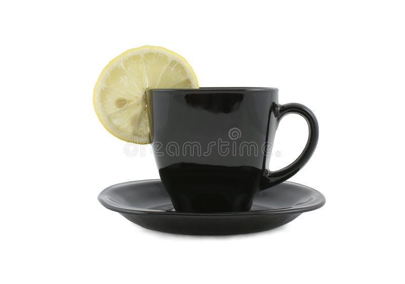 Schwarzer Tasse Kaffee mit Zitrone lizenzfreie stockfotos