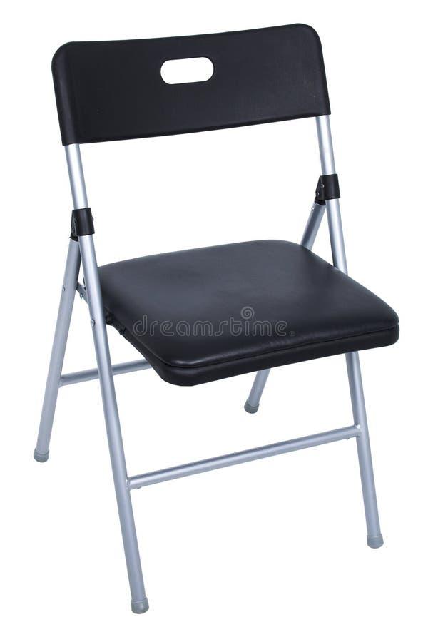 Schwarzer und silberner Falte-Stuhl über Weiß lizenzfreie stockbilder