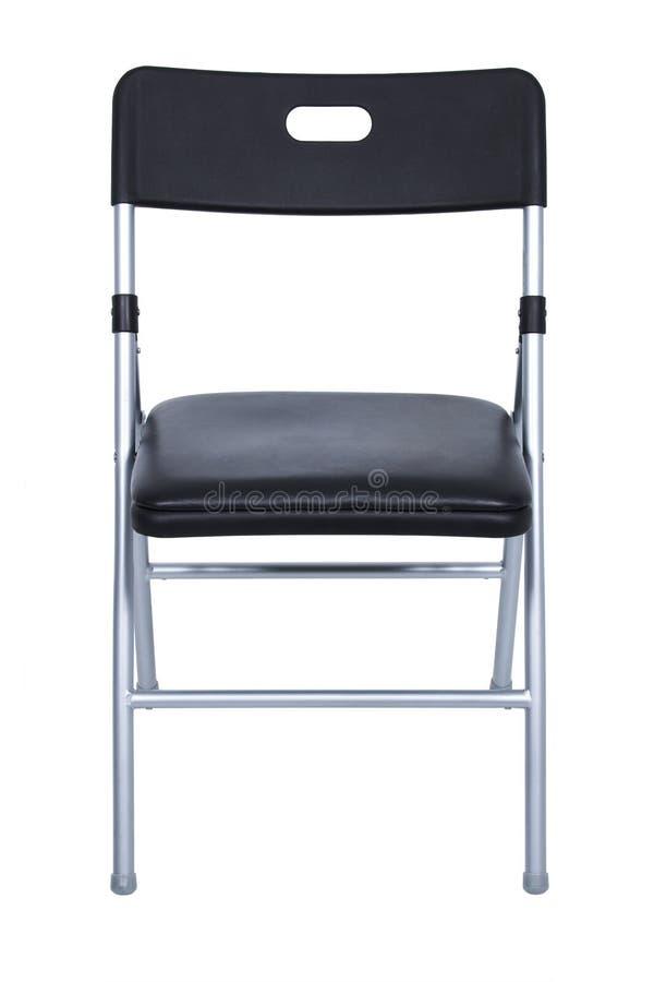 Schwarzer und silberner Falte-Stuhl über Weiß stockbild