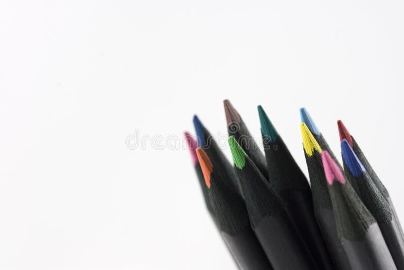 Schwarzes farbige Bleistifte lizenzfreie stockbilder