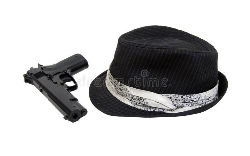 Schwarzes Fedora und Gewehr lizenzfreie stockbilder