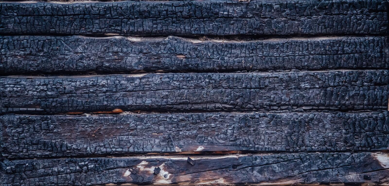 Schwarzes gebrannte hölzerne Wand lizenzfreie stockfotos
