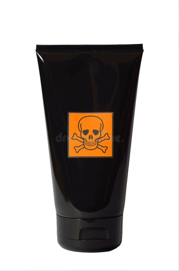 Schwarzes Kosmetikrohr mit Warnschild stockfotografie