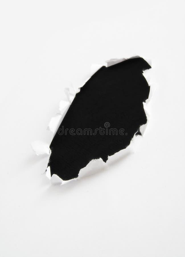 Schwarzes Loch im Papier lizenzfreie stockfotografie