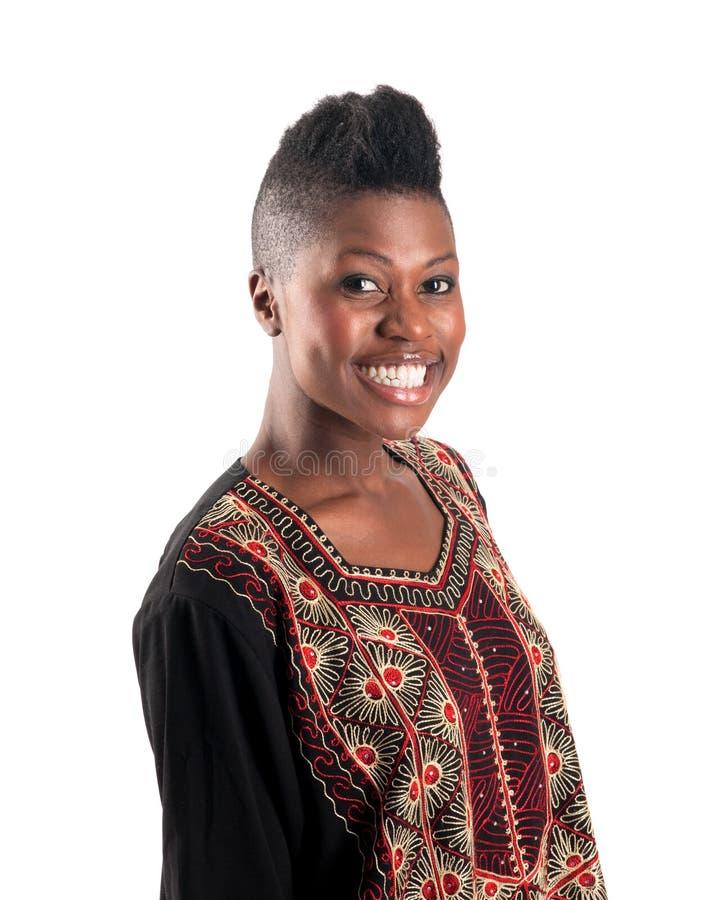 Schwarzes Mädchen mit warmem Lächeln stockbild