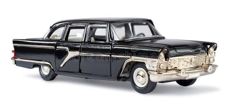 Schwarzes metallisches Retro- Spielzeugauto lokalisiert auf Weiß stockfotos