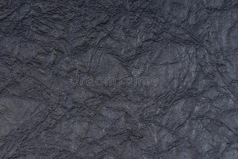 Schwarzes selbst gemachtes Papier drückte Blattbeschaffenheitshintergrund Prägeartiges Spitzemuster stockbilder