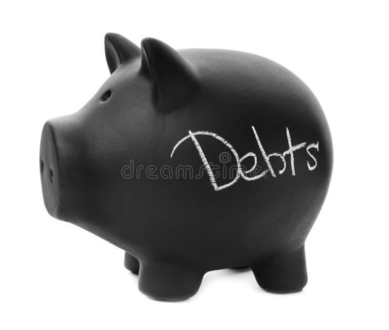 Schwarzes Sparschwein mit Wort SCHULDEN lizenzfreie stockbilder