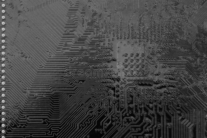 Schwarzes Stromkreis mainboard des Computerhintergrundes lizenzfreie stockfotos