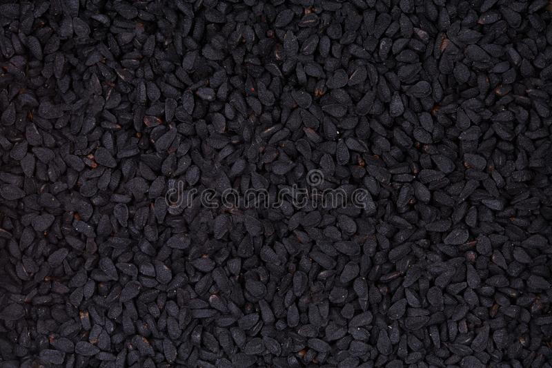 Schwarzkümmelsamen, Nigella Sativa - Nahaufnahmehintergrund stockbild