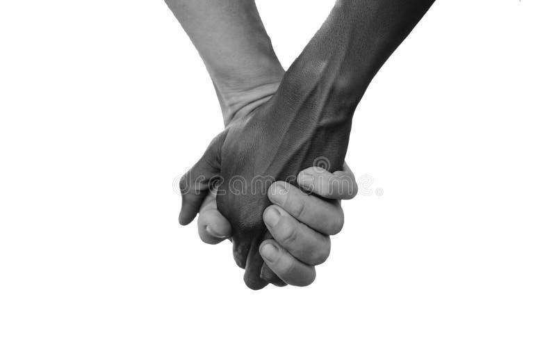 Schwarzweiss-Griff-Hände für Afrika-Verbands-Friedensliebe Nein zum Ra lizenzfreies stockbild