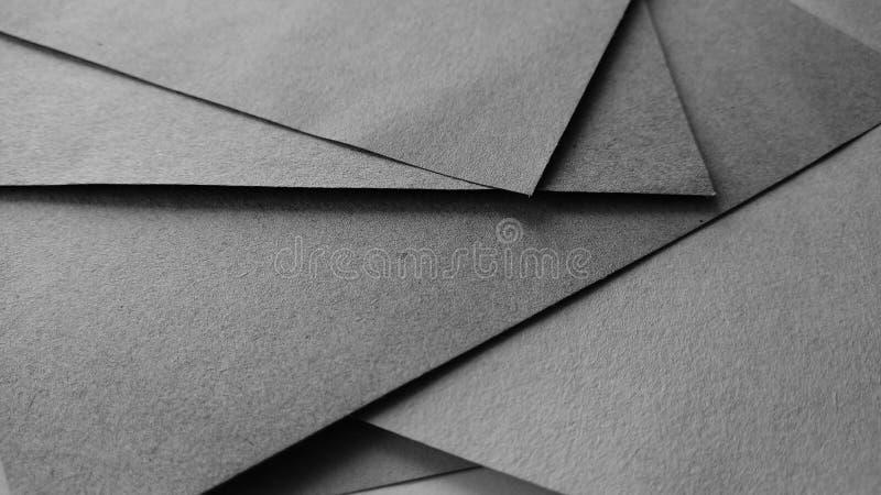 Schwarzweiss-Papierkunst- und Handwerkshintergrund lizenzfreies stockfoto