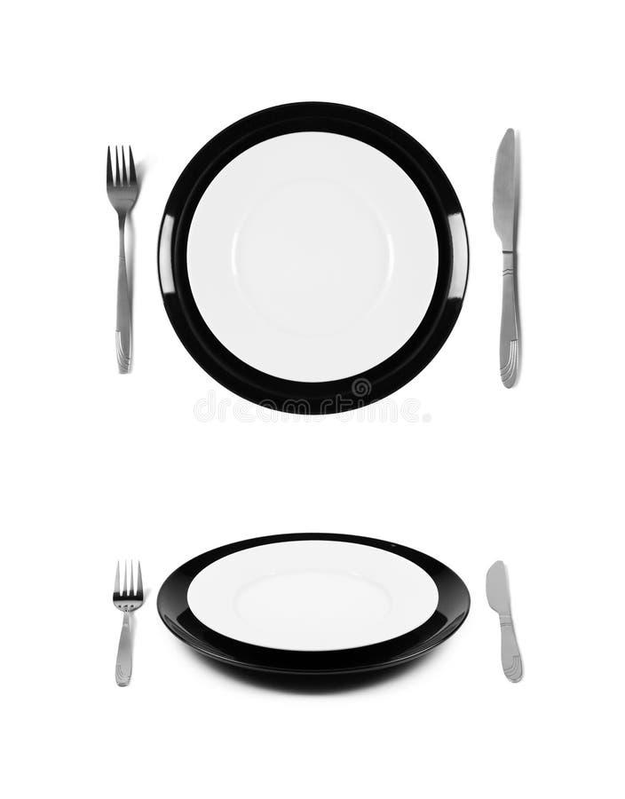 Schwarzweiss-Platten mit Gabel und Messer lizenzfreie stockfotos