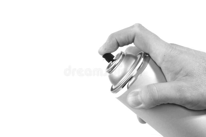 Schwarzweiss-Spraydose mit dem Finger, der die Taste eindrückt stockbilder