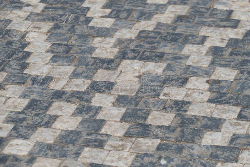 Schwarzweiss-Würfel cobbles Muster lizenzfreies stockbild