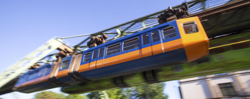 Schwebebahn train wuppertal germany speeding. A schwebebahn train in wuppertal germany speeding stock photo