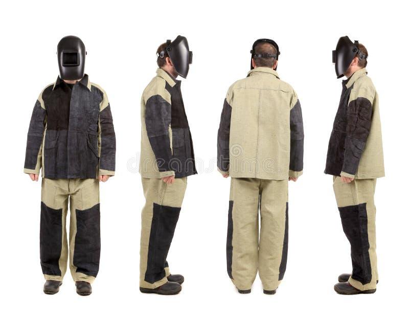 Schweißer in der Arbeitskleidungsklage. lizenzfreies stockbild