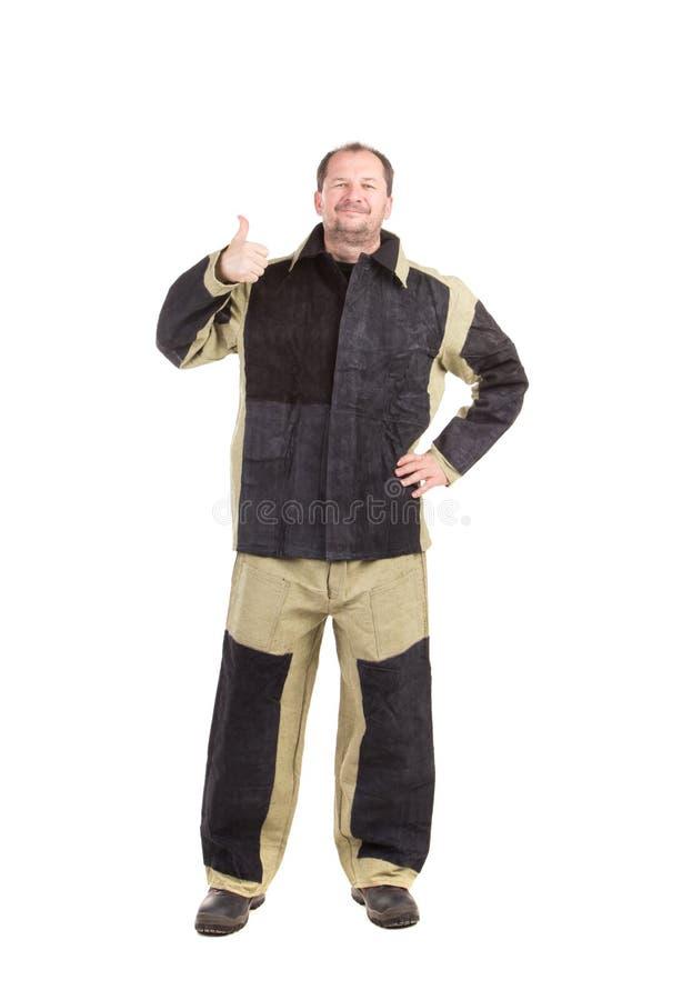 Schweißer in der Arbeitskleidungsklage stockfoto