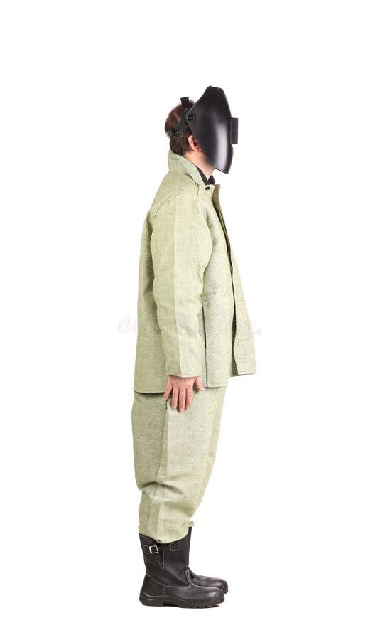 Schweißer in der Arbeitskleidungsklage mit Maske lizenzfreie stockfotos