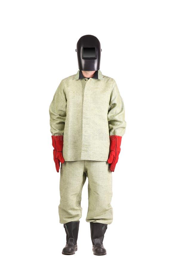 Schweißer in der Arbeitskleidungsklage mit Maske stockfoto