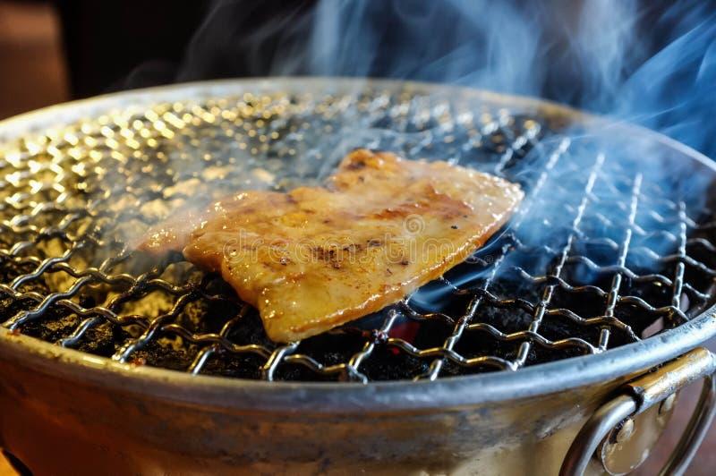 Schweinefleisch-Grill stockbild