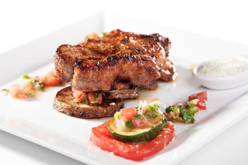 Schweinefleisch-Steak stockbilder