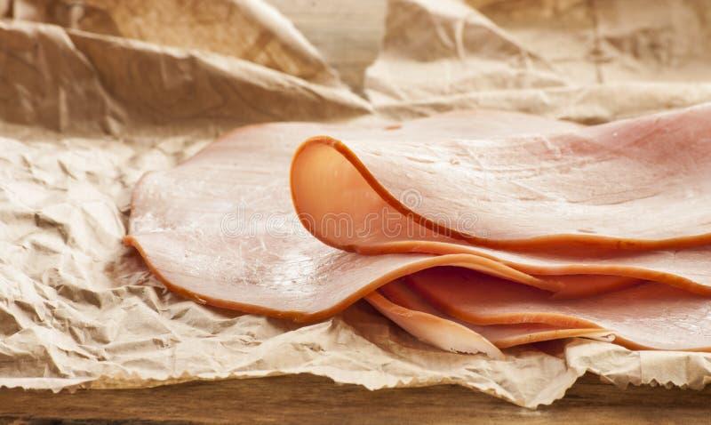 Schweinefleischschinkenscheiben stockbild
