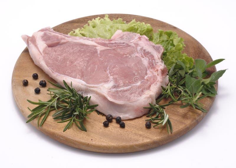 Schweinefleischsteak stockfotografie