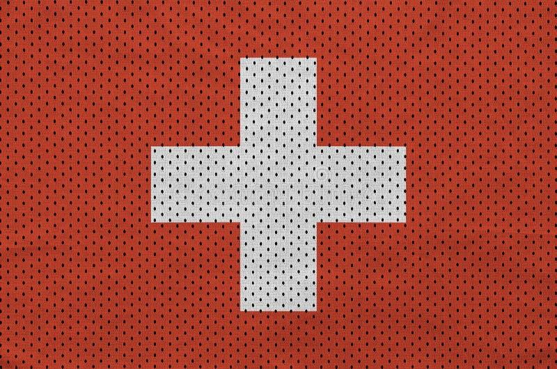 Schweiz flagga som skrivs ut på en fa för ingrepp för polyesternylonsportswear royaltyfri fotografi