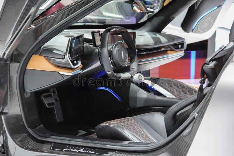Schweiz; Genève; Mars 10, 2019; Pininfarina Battista Electric Hypercar inre; Den 89th internationella motorshowen i Genève royaltyfria bilder