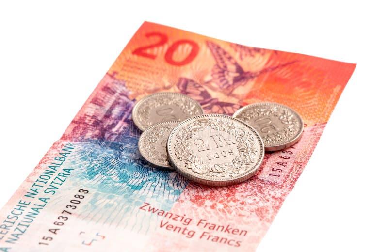 Schweizer Banknote und Münzen lizenzfreie stockfotografie