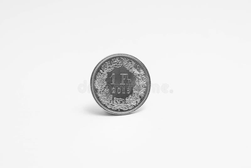 Schweizisk franc en 1 CHF som isoleras på vit arkivbild