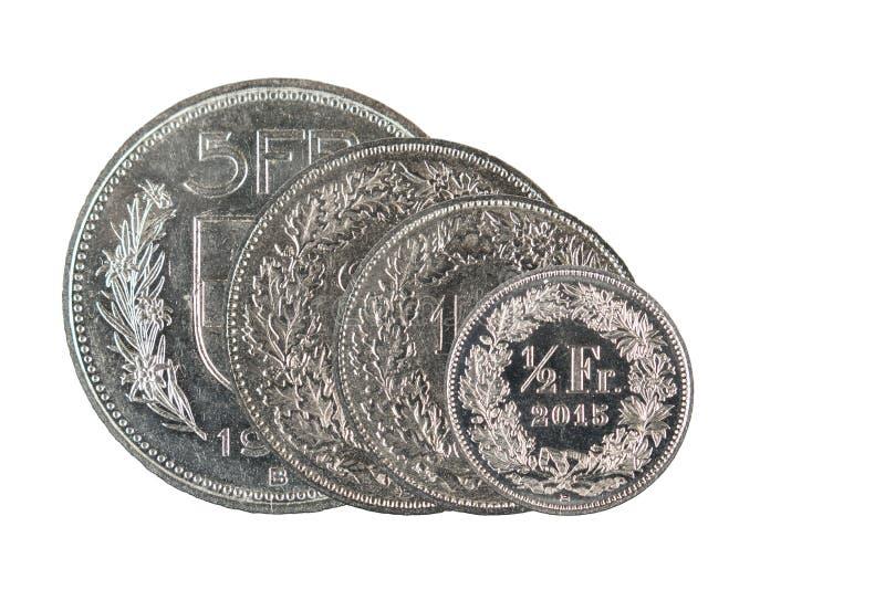 1, 2 5 schweizisk franc och centmynt för 50 schweizare med vit bakgrund royaltyfria foton