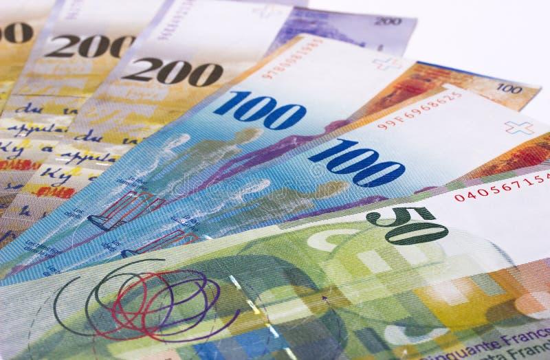Schweizisk francpengar som isoleras på vit bakgrund arkivfoto