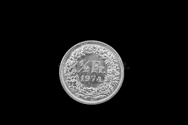 Schweiziska halva Franc Coin Isolated On en svart bakgrund arkivbilder