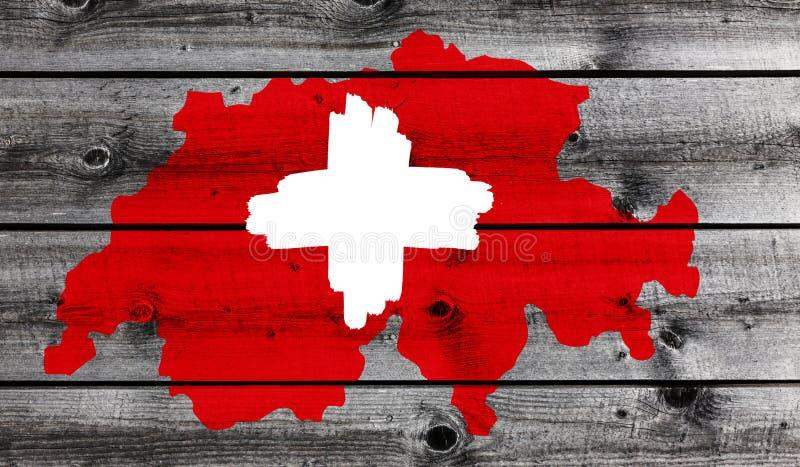Schweiziskt kors på trä arkivbild