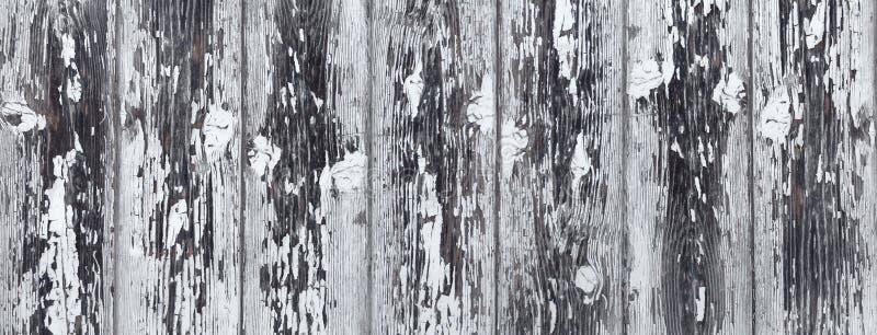 Schwer verwitterte weiße graue hölzerne Wand stockfotos