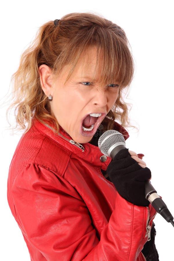 Schwingfrau in einer roten Lederjacke stockbild