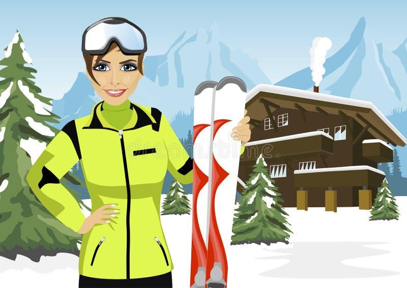 Sciatore femminile della montagna che sta davanti al chalet nella stazione sciistica di inverno illustrazione di stock