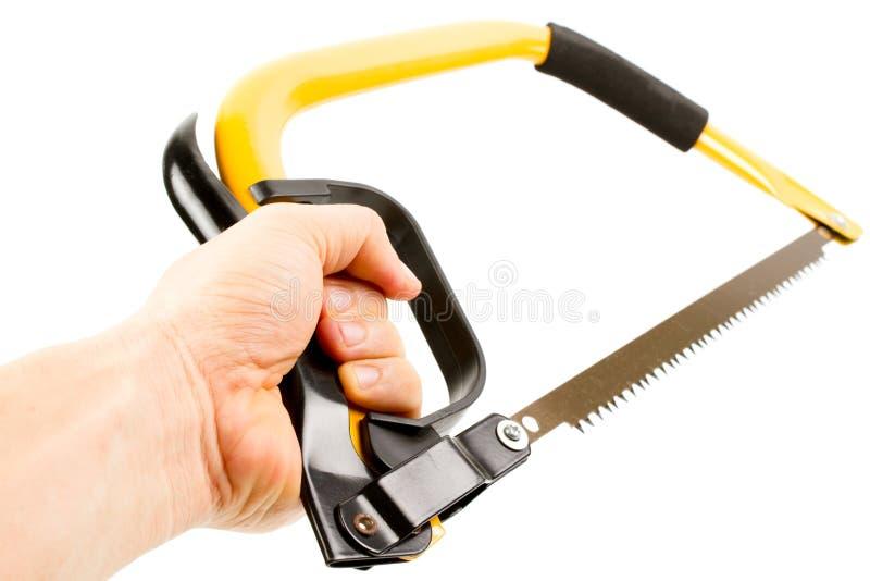 Scie jaune d'arc avec la main images stock