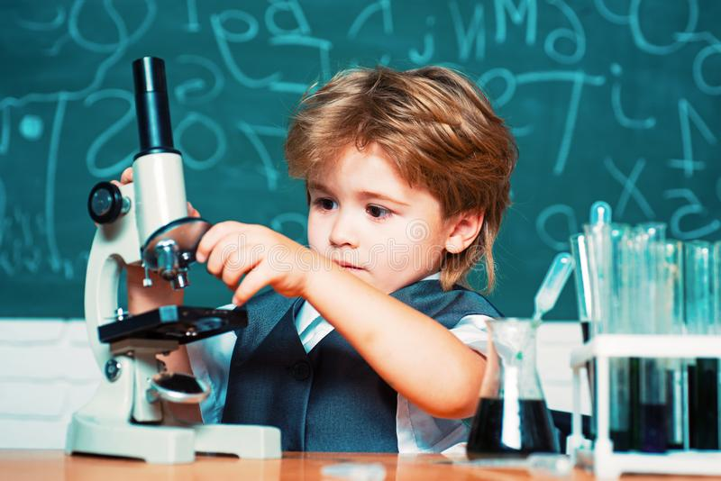 Science and education concept. Chemistry science. Elementary school. schoolboy. Cheerful smiling little boy having fun royalty free stock photography