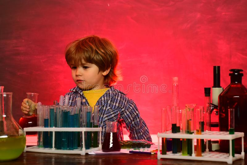 Science and education concept. First school day. Elementary school. Ready for school. Little children at school lesson stock photo