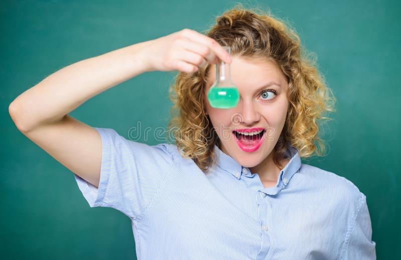 Science and education. girl hold chemical flask with liquid. happy student with beaker. biology experiment. sample stock photo